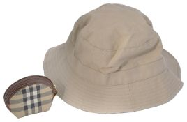 A Burberry canvas bucket shaped hat and coin purse