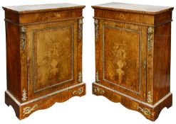 A pair of Victorian figured walnut and floral marquetry inlaid pier cabinets