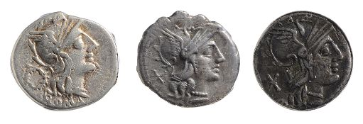 "Titus Cloelius Silver Denarius128 BCHelmeted head of Roma right, wreath behind ""ROMA"" below /"