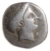 Euboia, Chalkis Silver DrachmCirca 338-308 BC. Head of the nymph Chalkis to right / Eagle standing