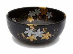 A Japanese black glazed porcelain bowl