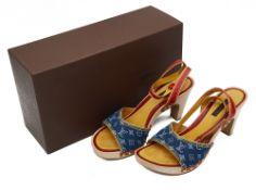 A pair of Louis Vuitton blue denim sandals