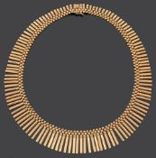 A Continental 18ct gold Egyptian style fringe necklace