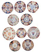 A collection of ten Japanese Meiji period imari palette fluted dishes