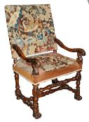 A late 17th century Flemish walnut and tapestry open armchair