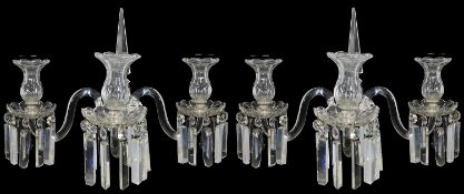 A pair of late Regency style cut glass three light wall appliques in the manner of Osler