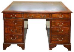 A large Victorian mahogany twin pedestal desk