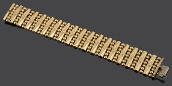 A Continental 18ct gold wide fancy articulated bracelet