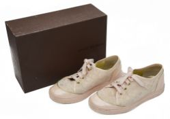 A pair of Louis Vuitton pale pink and gold monogrammed trainers