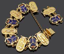 An Egyptian revival style yellow metal and enamel scarab bracelet