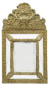 A 19th century Flemish embossed brass cushion wall mirror in 17th century style