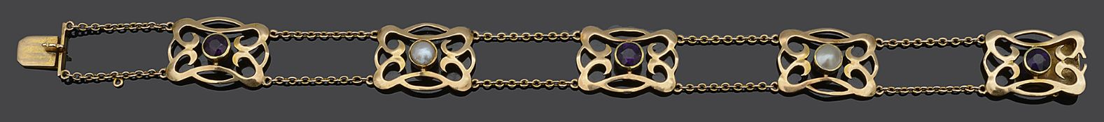 An Art Nouveau amethyst and blister pearl scroll panel bracelet