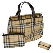 A Burberry handbag, make up bag and key wallet