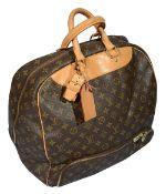A Louis Vuitton monogrammed travel bag