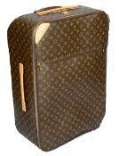 A Louis Vuitton monogrammed canvas 'Pegase Legere 65' suitcase