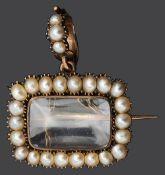 A Georgian half pearl framed memorial locket/brooch