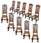 A set of ten William and Mary style oak high slat back dining chairs