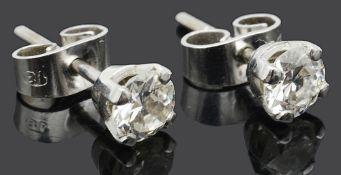A pair of small single stone diamond set stud earrings