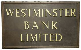 A large Westminster Bank Limited bronze sign