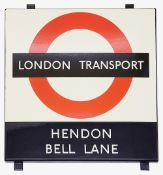 A London Transport enamel Bus stop sign 'HENDON / BELL LANE',1950s/60s, black and red roundel on a