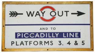 A c.1930s London Underground enamel direction sign showing 'WAY OUT / AND TO / PICCADILLY LINE /