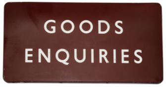 A BR(M) enamel sign displaying 'GOODS ENQUIRIES',white lettering on maroon ground, height 45.7cm,