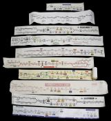 A group of paper and vinyl London Underground carriage line diagrams