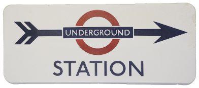 A London Underground enamel direction sign displaying 'UNDERGROUND / STATION',blue lettering on