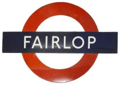A London Underground enamel station roundel for Fairlop,in three parts consisting of nameplate of