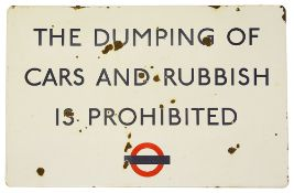 A London Transport enamel sign displaying 'THE DUMPING OF CARS AND RUBBISH IS PROHIBITED',blue