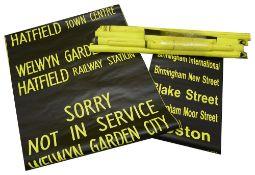 A bundle (9) of black on yellow destination blinds