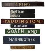 A group of enamel, metal, wooden and cardboard Railway-related signs