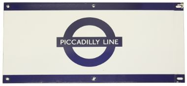 A London Underground enamel station frieze sign for 'PICCADILLY LINE',blue edging and roundel on