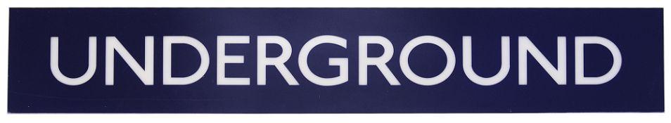 A London Underground sign displaying 'UNDERGROUND'