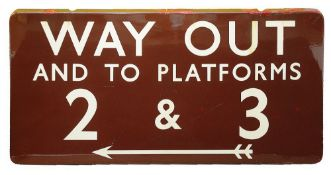 A BR(M) enamel sign displaying 'WAY OUT / AND TO PLATFORMS / 2 & 3',with white lettering on a maroon