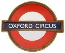 A London Underground Oxford Circus enamel 'bullseye' roundel sign,in bronze frame and mounted on
