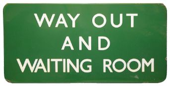 A BR(S) region enamel sign displaying 'WAY OUT AND WAITING ROOM',with white lettering on a green