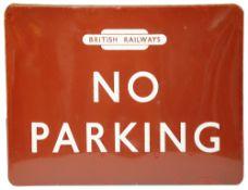 A BR(M) enamel sign displaying 'NO PARKING'