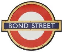 A London Underground Bond Street enamel 'bullseye' roundel sign,in bronze frame and mounted on
