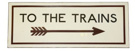 A London Underground enamel sign displaying 'TO THE TRAINS',black lettering on a white ground with