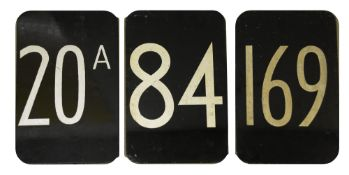 Three bus route number plates