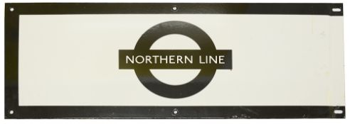 A London Underground enamel station frieze sign for 'NORTHERN LINE',black edging and roundel on