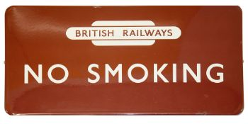 A BR(M) enamel sign displaying 'NO SMOKING' with British Railways totem,white lettering on maroon