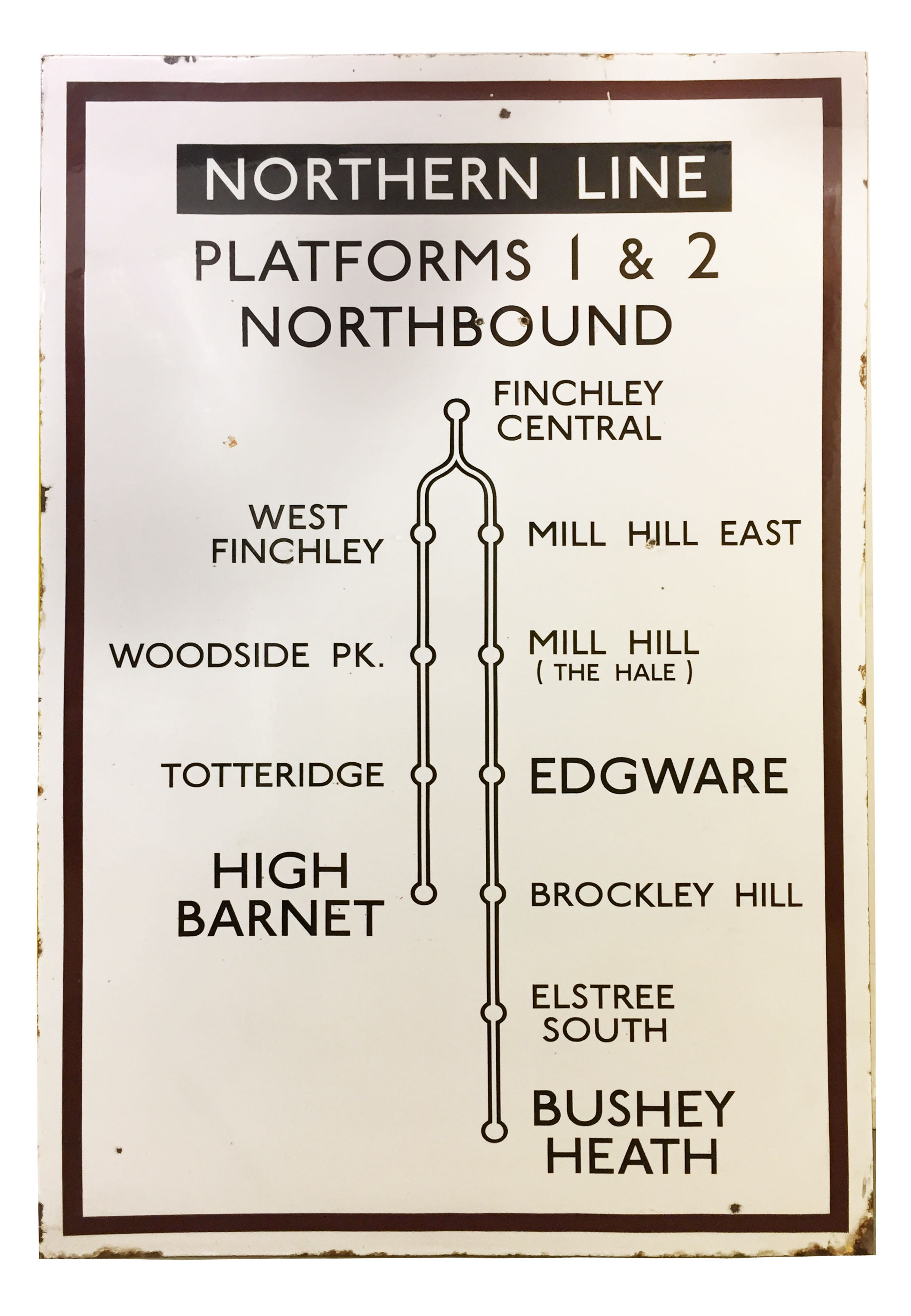 A 1930s London Underground enamel direction sign from East Finchley station displaying 'NORTHERN