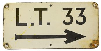 An enamel directional sign displaying 'L.T. 33'