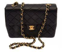 A Chanel black quilted lambskin mini flap 1989 handbag
