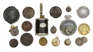 A small collection of coins medals and curios