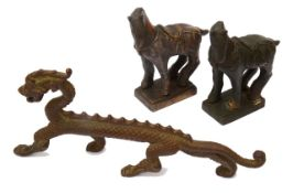 A Chinese bronze figure of a standing dragon and two Tang style bronze horses, (3)
