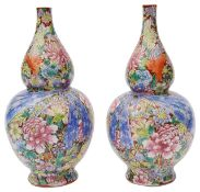 A pair of Chinese famille rose millefleur double gourd vases