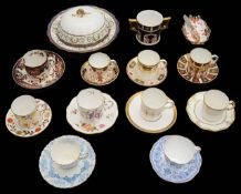 A collection of Royal Crown Derby coffee cups and saucers to include muffin dish and cover